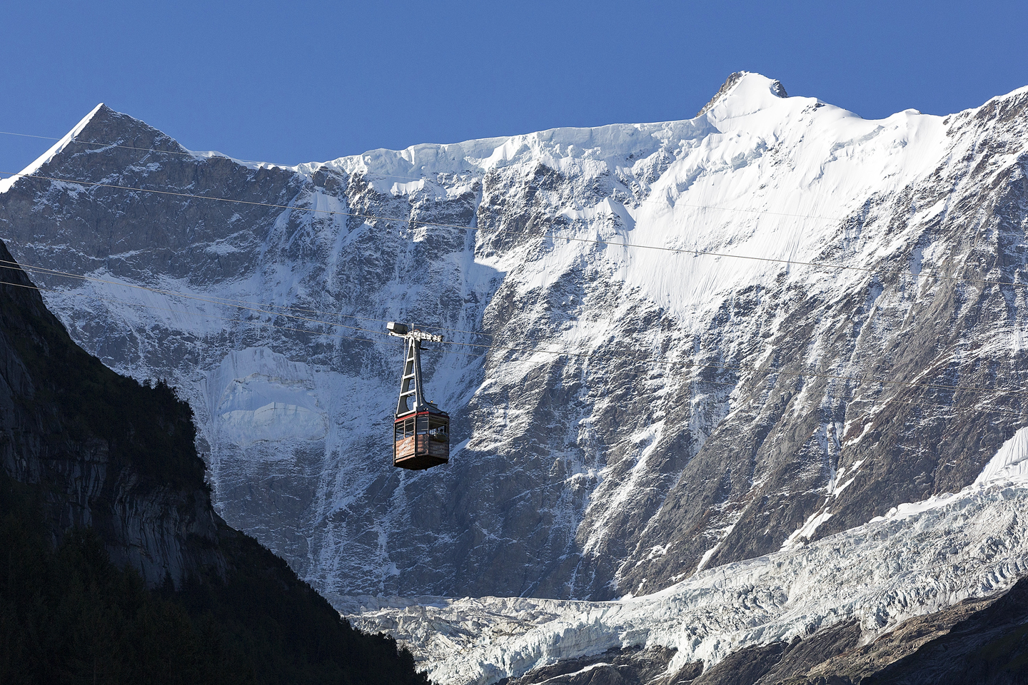 glacier covered mountain with a cable car near Grindelwald